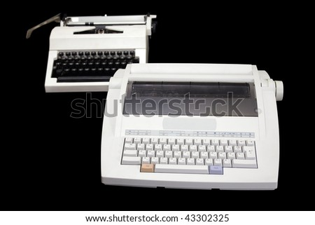Two  white typewriters of different generations on a black background