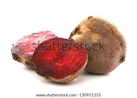 Two whole beetroots also called red beet on white background one cut - stock photo