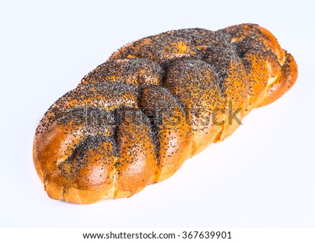 Two whole fresh challah bread with poppy and sesame seeds on a white background - stock photo