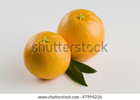 Two whole Oranges Isolated on White with Leaves Horizontal - stock photo