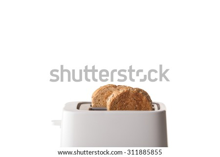 Two whole wheat bread and white toaster on isolated background. - stock photo