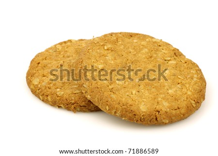 two wholemeal cookies on a white background