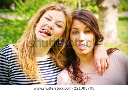 Two wild girls in the park - stock photo