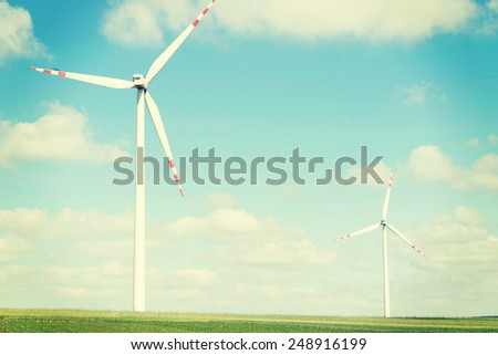 Two windmill power generators on summer day. - stock photo