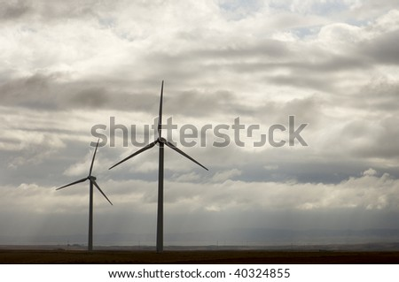 two windmill with stormy sky