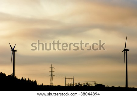 two windmills and electrical substation - stock photo