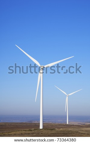 two windmills for electric power generation alternative - stock photo