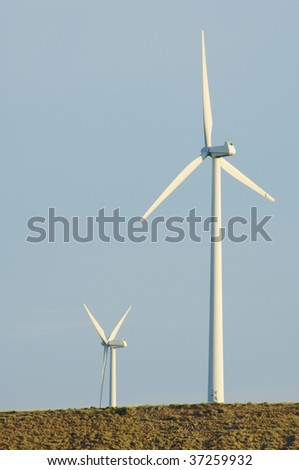 two windmills in a hill