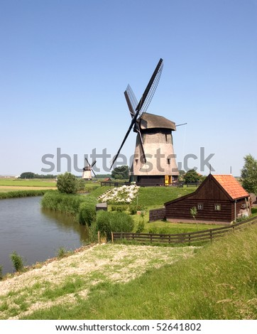Two windmills in the countryside near Amsterdam, the Netherlands - stock photo