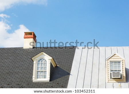Two Windows and a Chimney on two continuous house roofs - stock photo