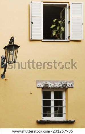 two windows and a lantern - stock photo