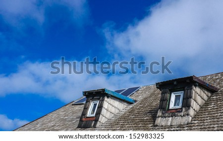 Two windows and garret roof - stock photo