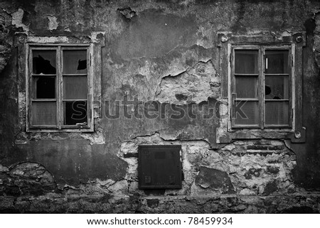 two windows in an abandoned house, black and white - stock photo