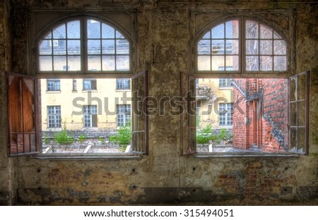 Two windows in an abandoned old room - stock photo