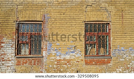 Two Windows in the wall from old bricks - stock photo