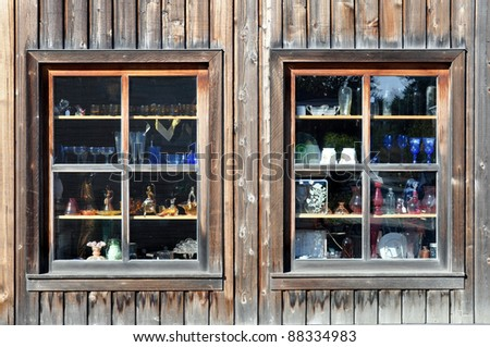 Two windows with antique glassware