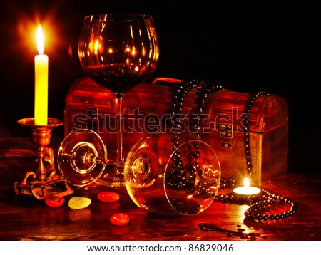 Two wine glass and candle on dark - stock photo