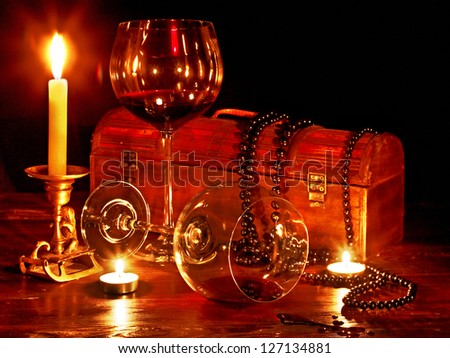 Two wine glass and candle on dark. Still life. - stock photo