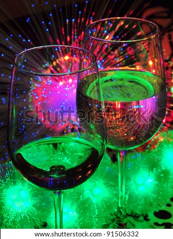 two wine glasses and Christmas lights - stock photo