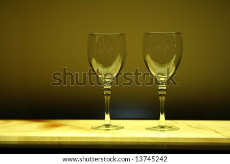 Two Wine Glasses on a Counter