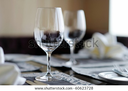 Two wine glasses on a table - stock photo