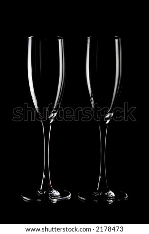 two wine glasses on black background