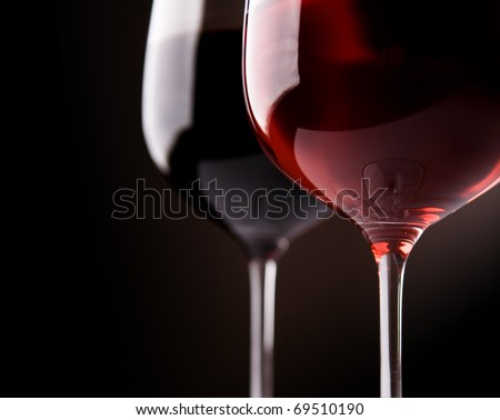 two wine glasses on black background - stock photo