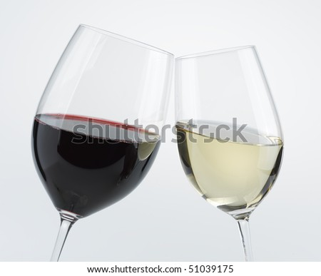 Two wine glasses red and white toasting - stock photo