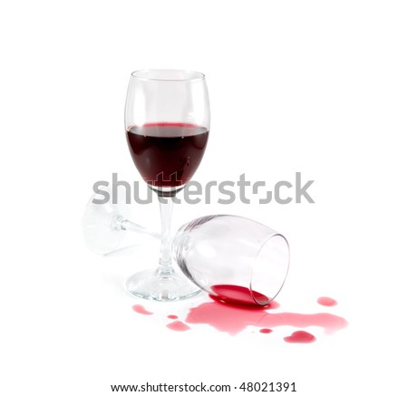 Two wine glasses. Spilled red wine. White background. - stock photo