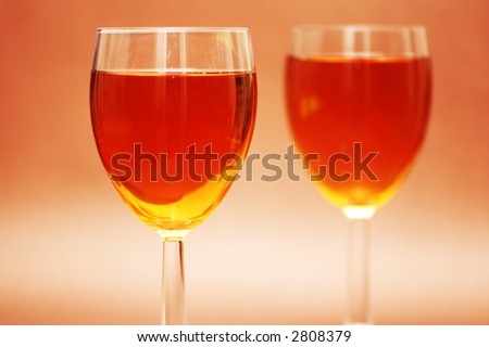 Two wine glasses  under the bright light - stock photo