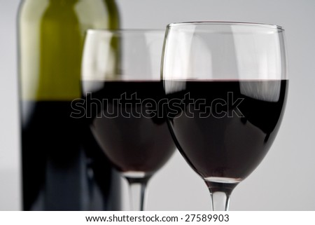 Two Wine Glasses with Green Bottle
