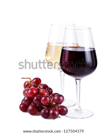 two wine glasses with red and white wine and grapes over white background - stock photo