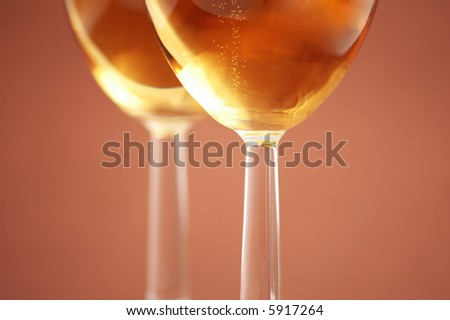 Two wine glasses with shallow depth of field - more similar photos in my portfolio - stock photo