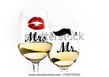 Two wine glasses with wine isolated on a white background. Glasses for woman and man. White wine. Happy lifestyle. Romantic. Rose. Pour a wine. Valentines background - stock photo