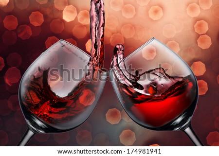 Two wine glasses with wine splash - stock photo