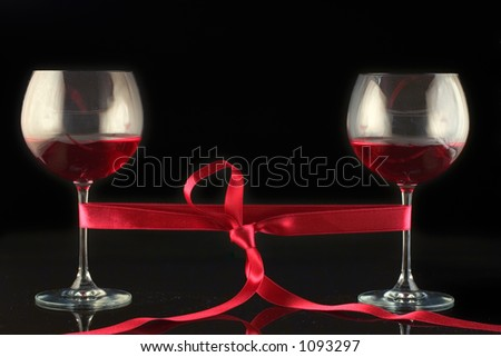 Two wine glasses wrapped with a tape