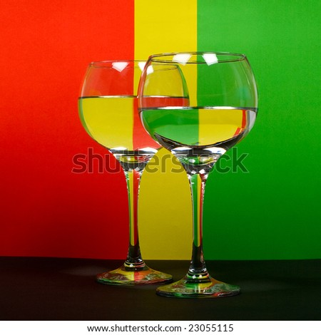 two wineglass in color background