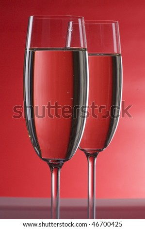 Two wineglasses of champagne  over colored  background