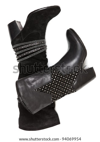 Two winter female boots against white background - stock photo