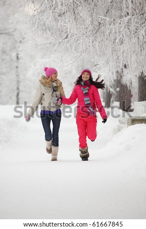 two winter women run - stock photo