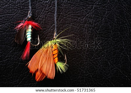 Two woblers on black leather  background - stock photo