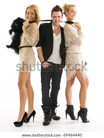 two woman a man and a pomeranian - stock photo