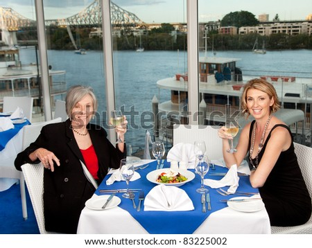 Two woman enjoying a lunch with a view - stock photo