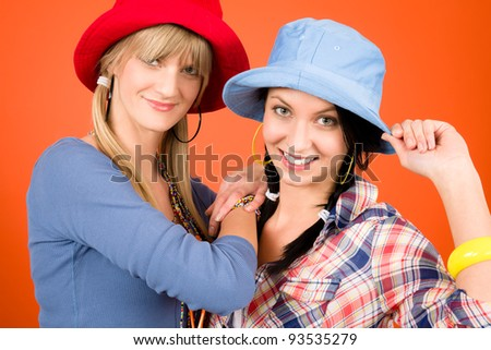 Two woman friends young wear funny hats smiling crazy outfit