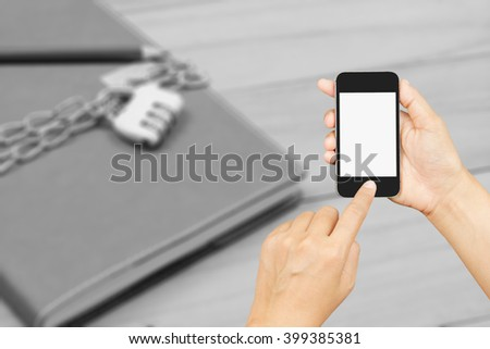 two woman hand holding and using smart phone,mobile, cell phone, tablet,with isolated screen over black and white notebook locked by chain and padlock background,safety privacy data in mobile concept  - stock photo