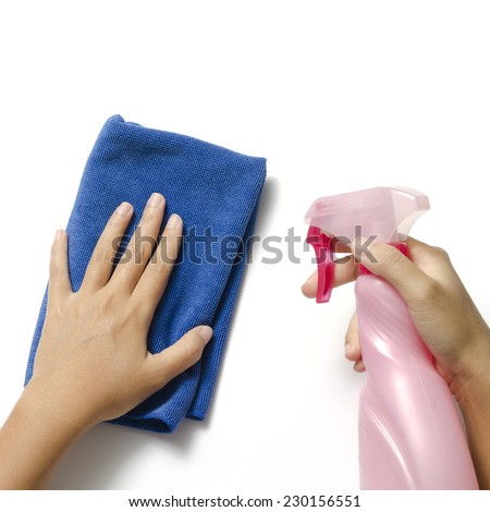 two woman hands cleaning with spray bottle and blue rag on a white background - stock photo