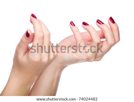 Two woman hands with red fingernail - stock photo