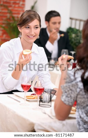 Two woman having lunch together - stock photo