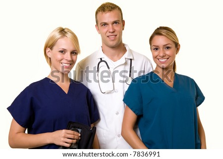 Two woman healthcare workers with one male in the middle wearing a doctors lab coat