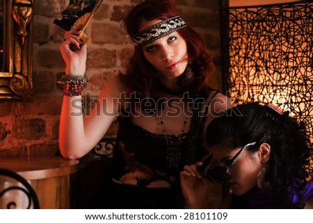 two woman in bar - stock photo